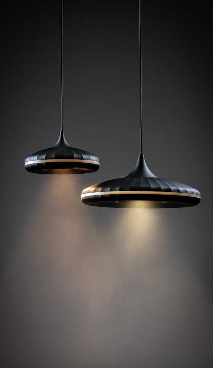 lris, decorative pendant luminaire with geometric design and perimeter cut allowing perfect ambient lighting
